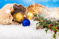 Christmas balls and santa s pack on the snow Royalty Free Stock Photography