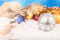 Christmas balls and santa s pack on the snow Stock Photo