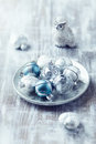 Christmas balls on a silver plate many ornaments Royalty Free Stock Photo