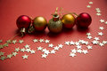 Christmas balls and stars on red background Royalty Free Stock Photo