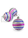 Christmas balls striped silver three with blue and pink stripes ball with a light shade on white background Stock Photo