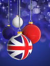 Christmas balls with united kingdom flag in front of lights background Royalty Free Stock Photography