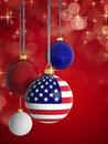Christmas balls with usa flag in front of lights background Stock Photos
