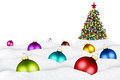 Christmas balls and xmas tree in snow Royalty Free Stock Photo