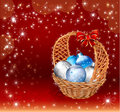 Christmas basket with decorations balls on red background Royalty Free Stock Photography