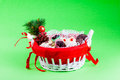Christmas basket a full of delicious pastry on a green background Royalty Free Stock Photos