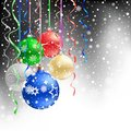 Christmas bauble black background the multicolored and ribbons on the mesh Royalty Free Stock Photo