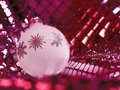 Christmas bauble in decorative back Stock Photos