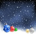 Christmas bauble night background the multicolored on the mesh Royalty Free Stock Images