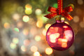 Christmas bauble over Beautiful magic bokeh background Royalty Free Stock Photo
