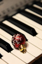Christmas Bauble on Piano Keys Royalty Free Stock Photos