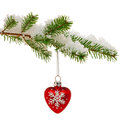 Christmas bauble on snow covered tree branch red heart shaped ornament hanging from the of a in isolated a white background Stock Photos