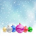 Christmas bauble snow the multicolored on the light blue mesh background Stock Images
