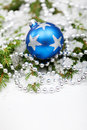 Christmas bauble on snowy branch Royalty Free Stock Photography