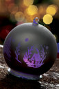 Christmas baubles on background of defocused lights Royalty Free Stock Photo