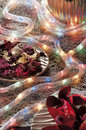 Christmas baubles on background of defocused lights candles Stock Images