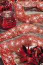 Christmas baubles on background of defocused lights candles Royalty Free Stock Photo