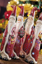 Christmas baubles on background of defocused lights candles Royalty Free Stock Images