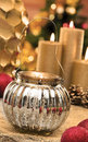 Christmas baubles on background of defocused lights candles Royalty Free Stock Photography
