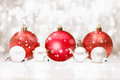 Christmas baubles in falling snow Stock Photography