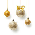 Christmas baubles gold balls decorated with bow ribbon collection on white background Royalty Free Stock Image
