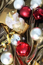 Christmas baubles on gold fabric shiny red and silver nestling in luxurious with a decorative wrapped gift box Stock Images