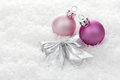 Christmas baubles pink balls with loop on artificial snow Stock Photography