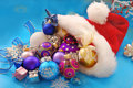 Christmas baubles in santa hat Royalty Free Stock Photo