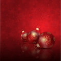 Christmas baubles on a snowflake background Royalty Free Stock Photos