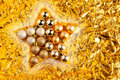 Christmas baubles in star shape on golden Royalty Free Stock Image