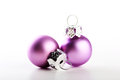 Christmas baubles two beautiful pink balls white background Stock Photos