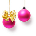 Christmas baubles two pink balls decorated with gold bow hanging on ribbon Stock Photo