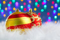 Christmas baubles on white fur and lights Royalty Free Stock Image