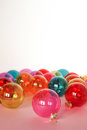 Christmas baubles in whte backround. Place for text. Royalty Free Stock Photo