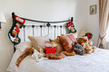 Christmas bedroom cosy interior with stockings on bedpost Stock Photography
