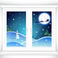 Christmas behind a window the snowman on snow slopes under light of the moon meets flying team of deer with santa in Stock Image