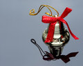 Christmas bell close up and red ribbon Royalty Free Stock Photo
