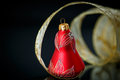 Christmas bell with gold ribbon Royalty Free Stock Photo