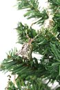 Christmas bell on green spruce branch Royalty Free Stock Photo