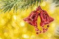 Christmas bell ornament hang on tree branch with yellow bokeh ba Royalty Free Stock Photo