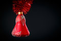 Christmas bell with red garland on a black background Stock Photography