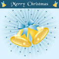 Christmas bells on blue sunburst Stock Image