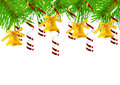 Christmas bells on fir branches hanging spruce a white background Royalty Free Stock Photo