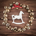 Christmas, bells on wood, christmas decorations, rocking horse Royalty Free Stock Photo