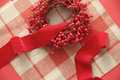 Christmas berries and ribbon on plaid Royalty Free Stock Photos
