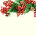 Christmas berries and spruce branch with cones Royalty Free Stock Photos