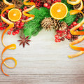 Christmas berries and spruce branch with cones oranges Royalty Free Stock Images