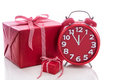 Christmas: big red gift box with red alarm clock - last minute c Royalty Free Stock Photo
