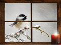 Christmas bird a cute chickadee in a snowstorm perched in front of a tiny farmhouse window curious about the glowing candle Stock Photography