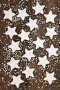 Christmas biscuits star gingerbread with silver balls over old oak wood background Royalty Free Stock Photo